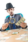 Detective detecting fake dollar banknotes — Stock Photo