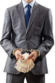 Handcuffed man with euro banknotes — Stock Photo