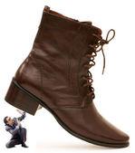 Concepto de dominación de mujer con hombre y zapatos — Foto de Stock