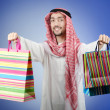 Arab with the gift bags - Photo
