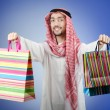 Arab with the gift bags - Stock Photo