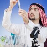 Arab chemist working in lab — Stock Photo #9375641