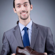 Man with a selection of shoes — Stock Photo #9375693