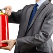 Man with fire extinguisher in firefighting concept — Stock Photo #9376605