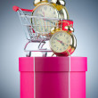 Buying time concept with clock and shopping cart — Stockfoto