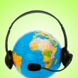 Headset on globe isolated on the white — Stock Photo #9377171