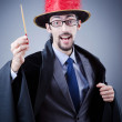 Magician in the business suit — Stock Photo #9377181