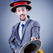 Magician in the business suit — Stock Photo #9377237