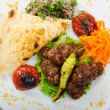 Meat cuisine - kebab served in plate — Stock Photo