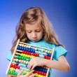 Girl playing with abacus — Stock Photo #9377312