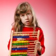 Girl playing with abacus — Stock Photo #9377323