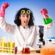 Chemist in lab experimenting with solutions — Stockfoto #9377629