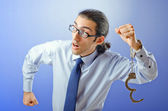 Businessman with handcuffs running away — Stock Photo