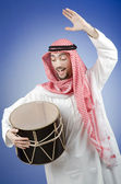 Arab playing drum in studio shooting — Stock Photo