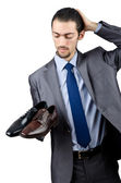 Man with a selection of shoes — Stock Photo