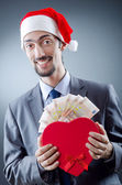 Santa with euro banknotes — Stock Photo