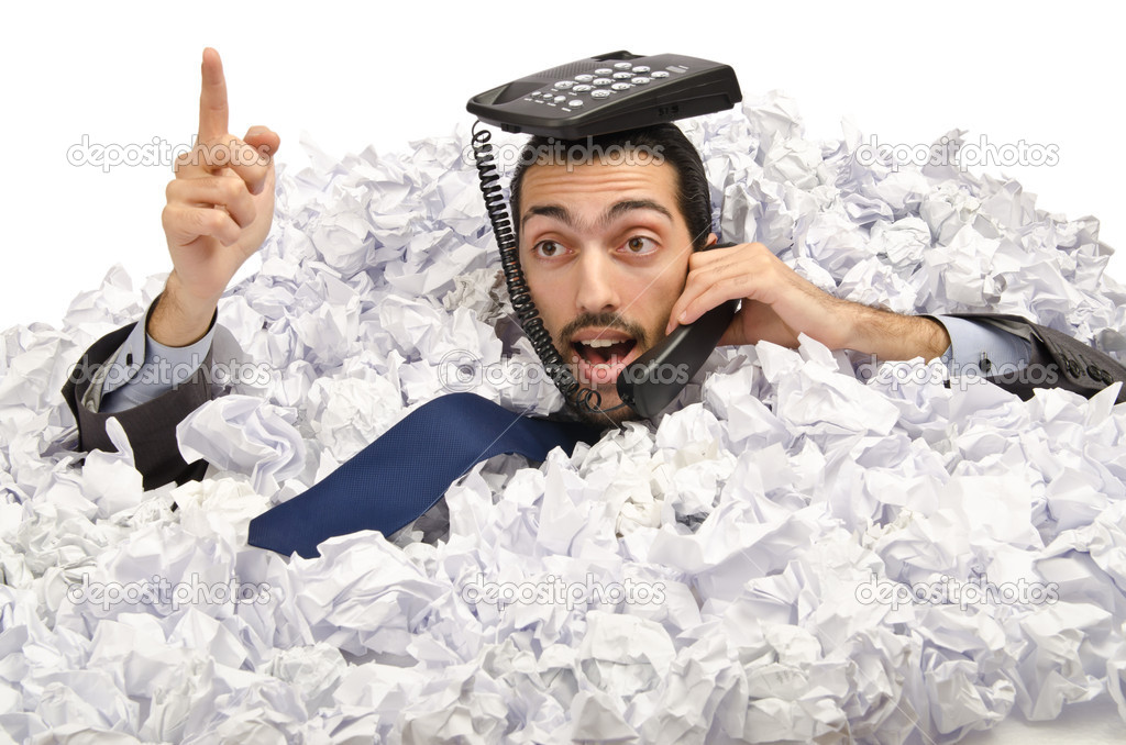 Man with lots of crumpled paper  Stock Photo #9376376