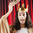 Funny king against red curtain — Stockfoto