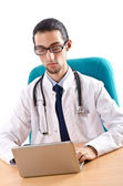 Male doctor working on laptop — Stock Photo