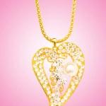 Golden jewellery against gradient background — Stock Photo