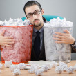 Mwith lots of wasted paper — Stock Photo #9470797