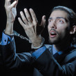 Stock Photo: Businessmjailed for his crimes