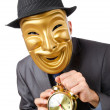 Masked mwith clock on white — Stock Photo #9471338