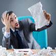 Businessman with lot of discarded paper - Stock Photo