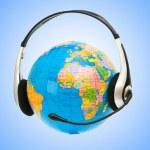 Headset on globe isolated on the white — Stock Photo