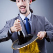 Stock Photo: Magiciin business suit