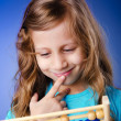 Stock Photo: Girl playing with abacus
