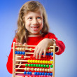 Girl playing with abacus — Stock Photo