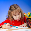 Little girl drawing with pencils — Foto de stock #9471546