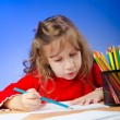 Стоковое фото: Little girl drawing with pencils