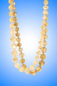 Nice necklace against gradient background — Stock Photo