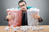 Man with lots of wasted paper — Stok fotoğraf