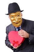 Masked man with giftbox on white — Stock Photo