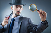Detective with the smoking pipe — Stock Photo