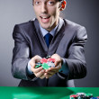 Casino player playing with chips — Stock Photo #9625236