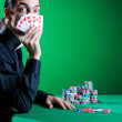 Player in casino and chips — Stock Photo #9625246