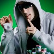 Player in casino and chips — Stock Photo #9625368