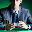 Player in casino and chips — Stock Photo #9625409