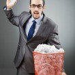 Man with lots of wasted paper — Stock Photo #9629866