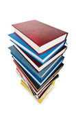 Books in high stack isolated on white — Stock Photo