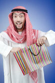 Arab with the gift bags — Stock Photo