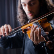 Stock Photo: Young violin player playing