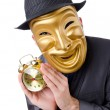 Masked man with clock on white — Stock Photo #9631187