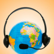 Headset on globe isolated on the white — Stock Photo