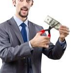 Man cutting money on white — Stock Photo #9631454