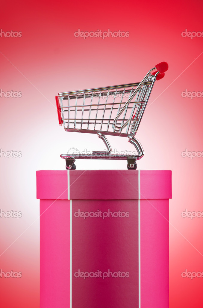 Cart and giftbox in christmas shopping concept — Stok fotoğraf #9631168
